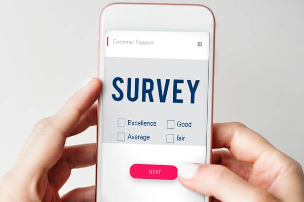 person filling post event survey questions on mobile